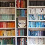 A book collection arranged in rainbow design