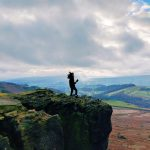 A woman standing on Stanage Edge
