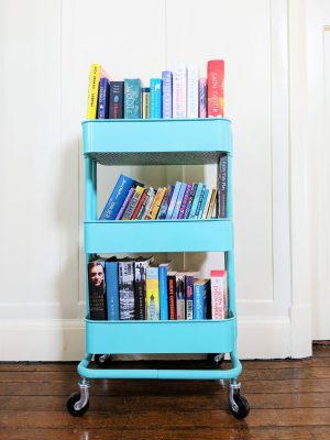Turquoise Book Trolley containing three shelves of books