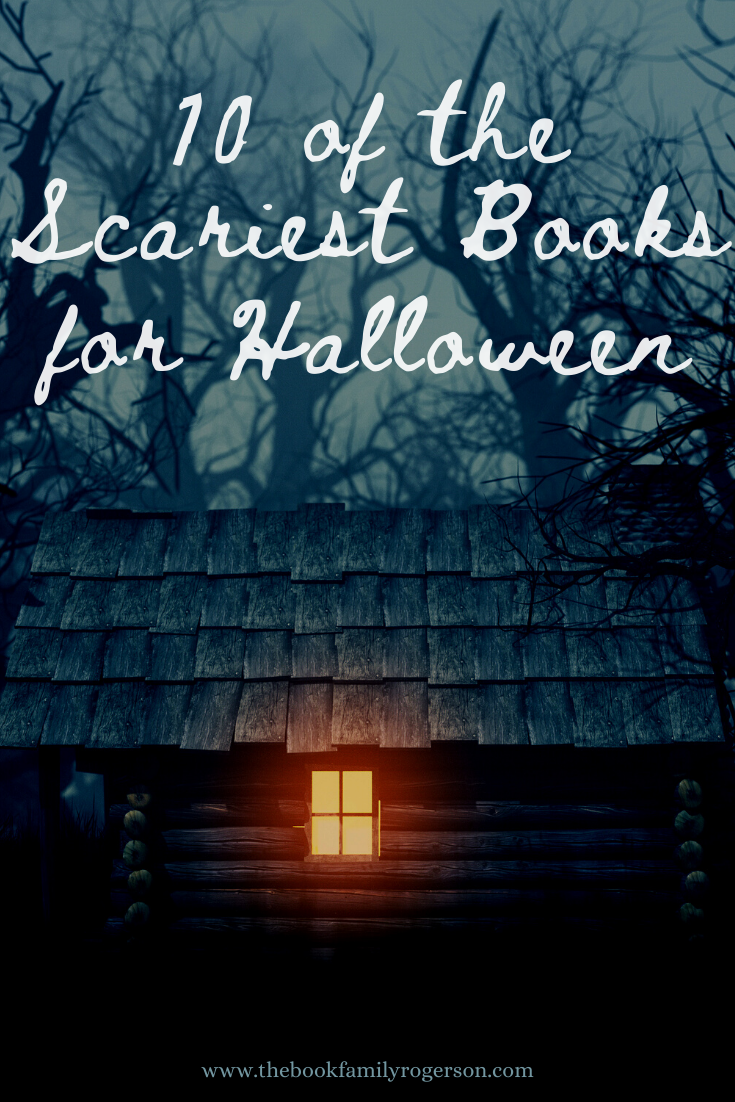 A hut in a spooky forest with one light on to represent scariest books for Halloween