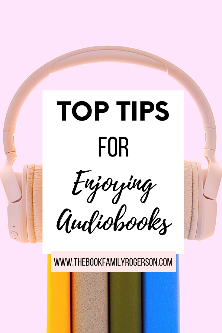 Pink headphones on books to represent top tips for enjoying audiobooks