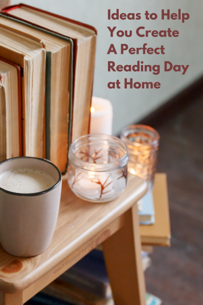 A cup of coffee on a table next to some books and a candle to illustrate ideas to help you create a reading retreat at home.