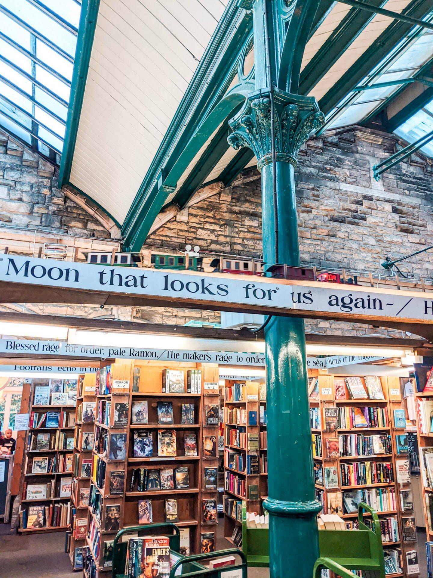 The model railway running above the bookshelves at Barter Books Alnwick