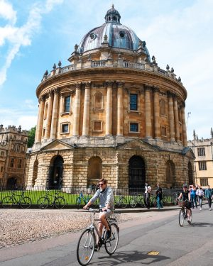 Cyclists passing the Radcliffe Camera in Oxford