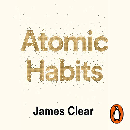 The title Atomic Habits written in a golden font which appears to disperse into atoms with the authors name James Clear in bold below.