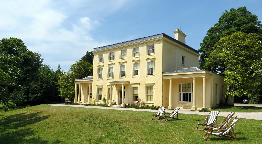 Agatha Christie's Holiday Home Greenway, a cream building with numerous windows overlooks a green lawn