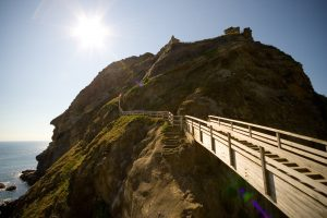 A wooden stairway winds up the hill to Tintagel Castle, Camelot